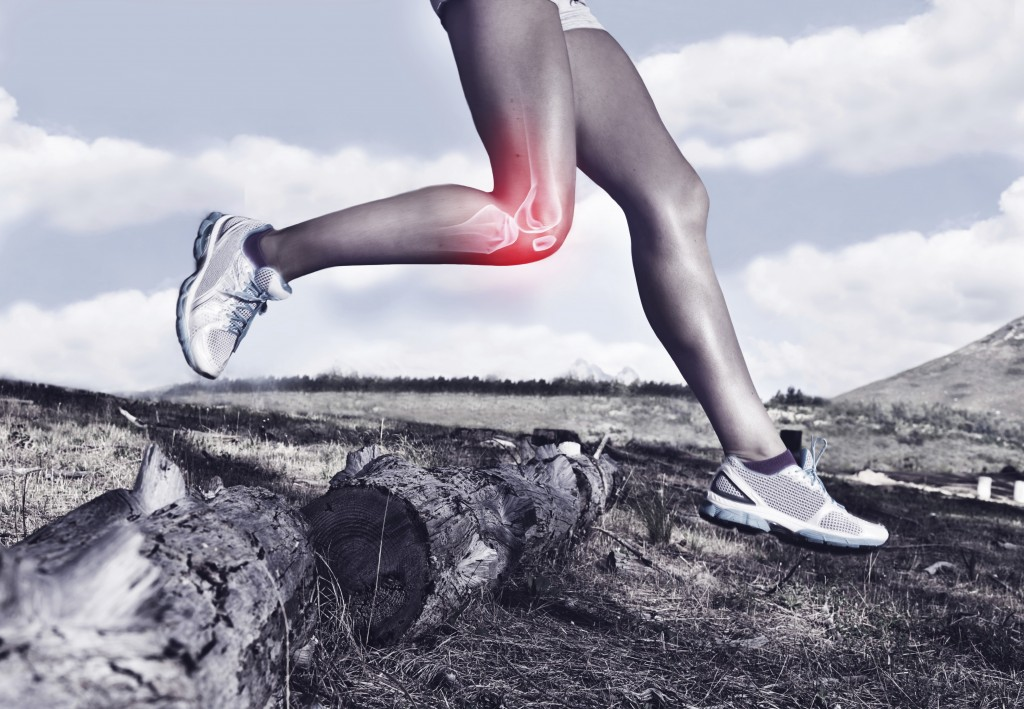 A cropped view of a female runner's legs with an injury
